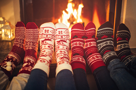 Friends at cozy winter vacation.